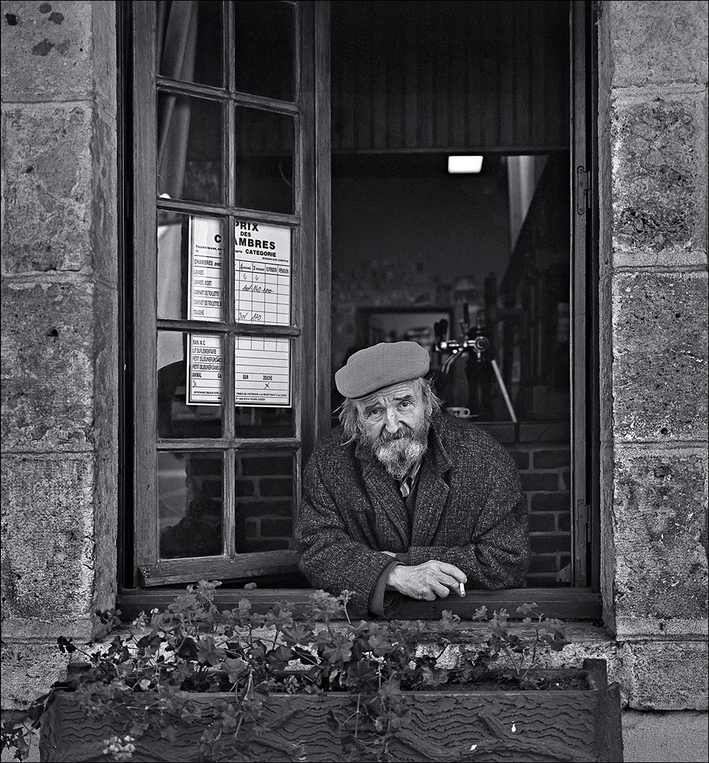man_in_window_france_c